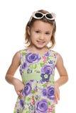 Cheerful little girl looks forward Stock Photography