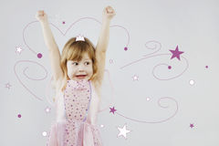 Cheerful little girl with magic stick with painted crown Royalty Free Stock Images