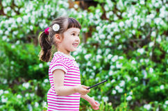 Cheerful little girl is a magician Stock Image