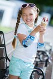 Cheerful little girl in the Park with ice cream cone Stock Image
