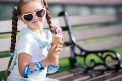 Cheerful little girl in the Park with ice cream cone Royalty Free Stock Photography