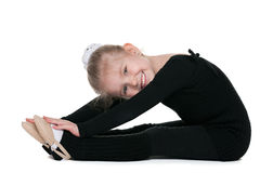 Cheerful little girl performs gymnastic exercise Stock Photo