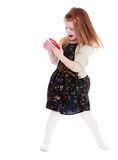 Cheerful little girl with a phone in his hand Royalty Free Stock Photos