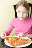 Cheerful little girl with pizza Stock Images
