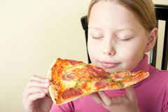 Cheerful little girl with pizza Royalty Free Stock Image