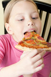 Cheerful little girl with pizza Royalty Free Stock Photography