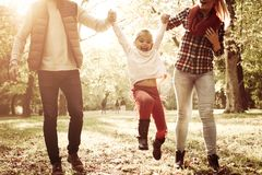 Little girl playing with parents and enjoying together royalty free stock images