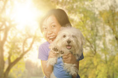 Cheerful little girl and puppy at the park Stock Photography