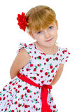 Cheerful little girl with red rose, braided hair. Joking in the studio. isolated on white background Stock Photography