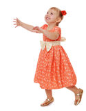 Cheerful little girl runs arms spread wide Royalty Free Stock Images