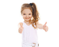 Cheerful little girl showing thumbs up. Portrait of cheerful little girl showing thumbs up Stock Photography