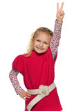 Cheerful little girl shows victory sign Stock Images