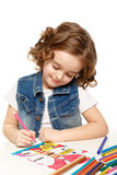 Cheerful little girl with sketch pen drawing in kindergarten Royalty Free Stock Photos