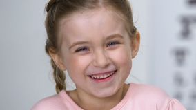 Cheerful little girl smiling on camera, childhood excitement, happiness concept. Stock footage stock video footage