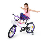 Cheerful little girl on a sports bike on a white background Stock Images