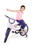 Cheerful little girl on a sports bike on a white background Stock Photos