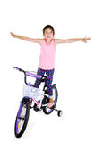 Cheerful little girl on a sports bike on a white background Stock Photography