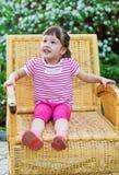 Cheerful little girl in the summer garden Stock Photos
