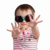 Cheerful little girl wearing glamorous glasses Royalty Free Stock Photography