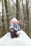 Cheerful little girl wearing warm clothes posing Stock Images