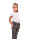 Cheerful little girl wearing white t-shirt and pants isolated on Royalty Free Stock Photos
