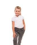 Cheerful little girl wearing white t-shirt and pants isolated on Royalty Free Stock Image