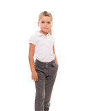 Cheerful little girl wearing white t-shirt and pants isolated on Royalty Free Stock Images
