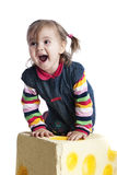 Cheerful little girl on a white background Stock Images