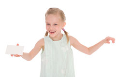 Cheerful little girl with white blank. Isolated on white background Royalty Free Stock Images