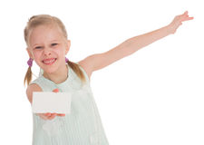Cheerful little girl with white blank. Isolated on white background Stock Photo
