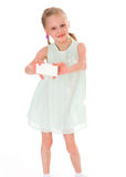Cheerful little girl with white blank. Isolated on white background Stock Image