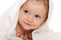 Cheerful little girl in the white towel Royalty Free Stock Photography