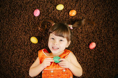 Cheerful little girls with eggs. easter eggs. top view. flat lay Stock Photography