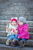 Cheerful little girls friends Stock Images