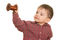 Cheerful little kid holding a roll of cooper wire Stock Photo