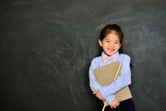 Cheerful little kid teacher finished teaching royalty free stock photography