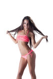 Cheerful long-haired girl posing in pink bikini Royalty Free Stock Images