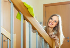 Cheerful long-haired woman cleaning  railings Stock Photos