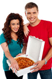 Cheerful love couple enjoying pizza together Stock Photos