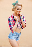 Cheerful lovely pin up girl standing and posing Stock Photos