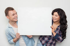 Cheerful loving couple is announcing great news Stock Photography