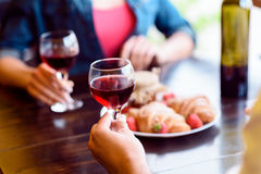Cheerful loving couple dating in restaurant Stock Images