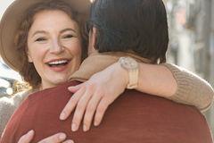 Cheerful loving couple embracing with fondness Royalty Free Stock Photos