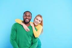 Cheerful loving couple embracing with joy Stock Image