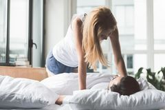 Happy woman flirting with her boyfriend in bedroom Royalty Free Stock Image