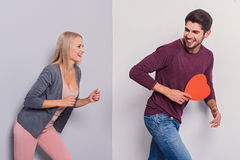 Cheerful loving couple having fun together Stock Photos