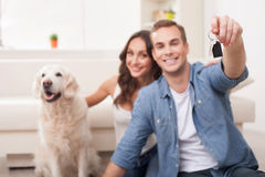 Cheerful loving couple is moving in new apartment Royalty Free Stock Images