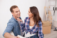 Cheerful loving couple is preparing for removal stock photography