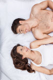 Cheerful loving couple is relaxing in bedroom stock photo