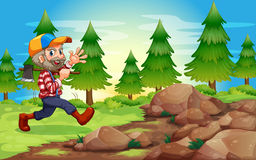 A cheerful lumberjack near the rocks Stock Photos